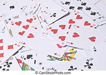 Playing cards - Set of playing cards are scattered on a...
