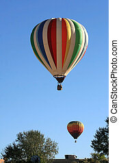 Hot Air Balloons fly over a residential area during the 2007...