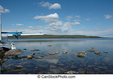 Northern lake - A float plane at rest in a lake in the...