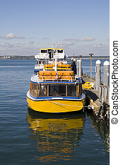 Yellow Ferry - A bright yellow ferry boat waiting at the...