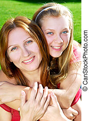 Mother and daughter - Portrait of a smiling mother and...