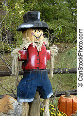Scarecrow - A scarecrow used in a beautiful seasonal display...
