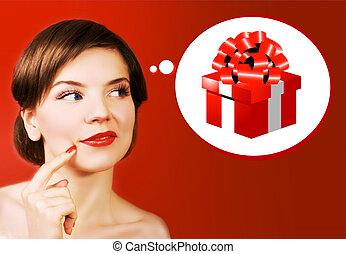 christmas girl - a dreaming christmas girl over the red...