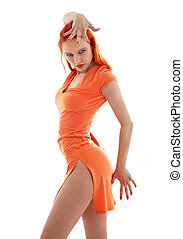 orange dance - dancing redhead in orange dress over white