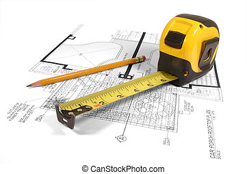 House Planning - A measuring tape and a pencil over a...