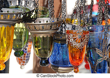 Tea Lamps - Colorful tea lamps hanging outside a shop in...