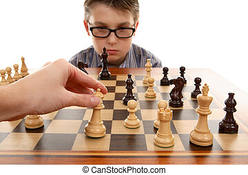 Playing Chess - Playing a game of chess.  White in play