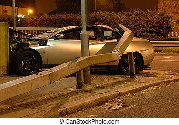 Car crashed under barrier at night