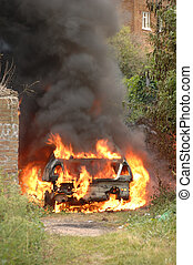 Stolen car on fire in alley way - A stolen car set fire to...