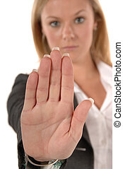 STOP - Blond women in business clothing with hand up...