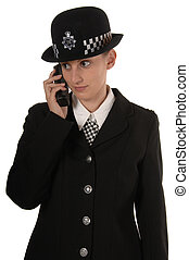 Female UK Police Officer using her radio - Uniformed UK...