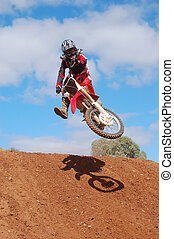 Drop Off - Motocross rider going over the drop off in style
