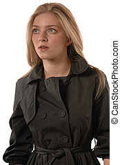Women in rain coat - Blond women in rain coat isolated on...