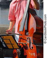 Double-bass street player performing jazz