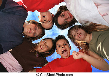 Happy Crazy Kids - Children in a Circle Against a Beautiful...