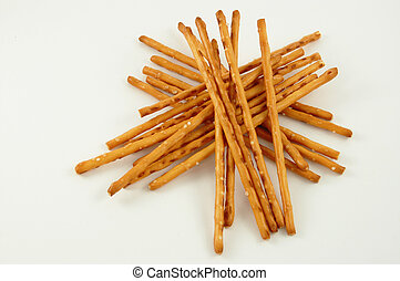 Pile of pretzel sticks on white background