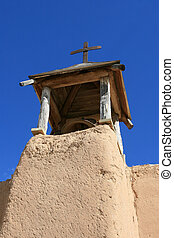 Adobe Bell Tower and Cross - Adobe bell tower of ancient...