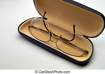 Eye Glasses - A pair of eye glasses in a open case