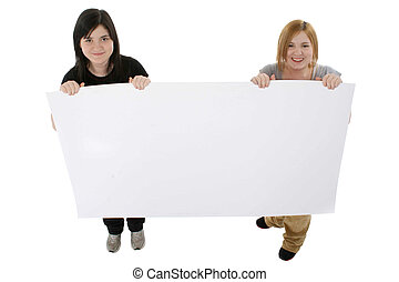 Teens with Poster - Two teens holding blank poster board up.
