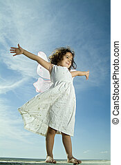 young girl flying - young girl with fairy wings flying...