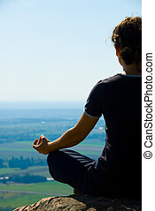 meditation - Woman on the top of a mountain meditation