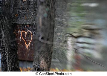 Dark Rusty Heart - Rusty metal door to a bunker, with a...