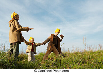 Yellow caps gnomes - Children wearing yellow caps playing on...
