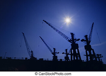Harbor cranes no.1 - Shapes of cranes at a cargo harbor in...