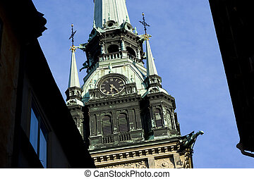 Clocktower - Looking up a clocktower in Gamla Stan,...