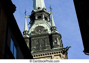 Clocktower - Looking up a clocktower in Gamla Stan,...
