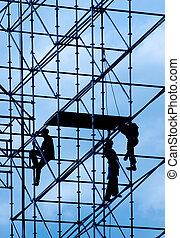 Builders - Silhouettes of builders on a background of the...