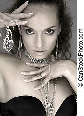 woman and jewellery - woman wearing black top and jewellery...