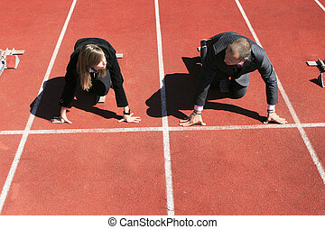 BUSINESS COMPETITION - Business man and woman challenging on...