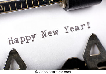 Happy New Year - Typewriter close up shot, concept of Happy...
