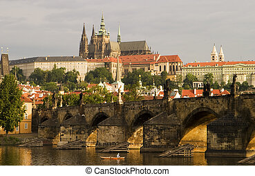 Prague Castle With Bridge - A view of the Prague Castle and...
