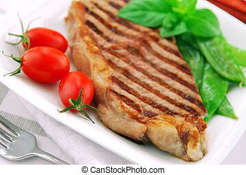 Grilled steak - Grilled New York steak served on a plate...