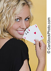 Winning Hand - A beautiful young blond woman smiling with a...