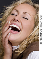 You Make Me Laugh - A beautiful young blond woman laughing...