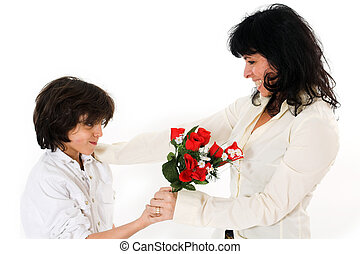 mothers day - teen offering his mom flowers over white...
