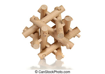 Wooden Puzzle - Wooden puzzle over white background.