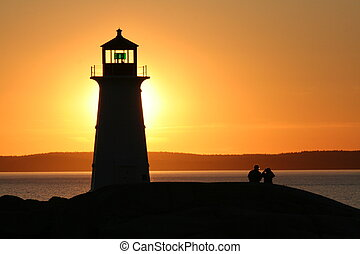 Couple at Lighhouse - A couple sitting next to the...