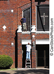 Painting Church - Contract painters removing old loose...
