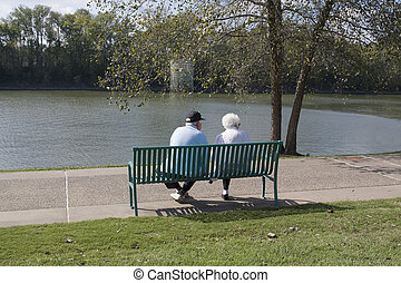 Retired elderly couple injoying a cool sunny fall day at the...