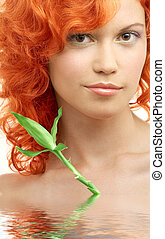 lovely redhead with bamboo in water - bright picture of...