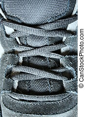 Black sneaker shoe laces - A close up of Black sneaker shoe...