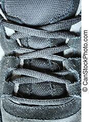 Black sneaker shoe laces - A close up of Black sneaker shoe...