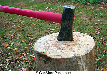 Axe in a log - A Wood splitting axe in a log