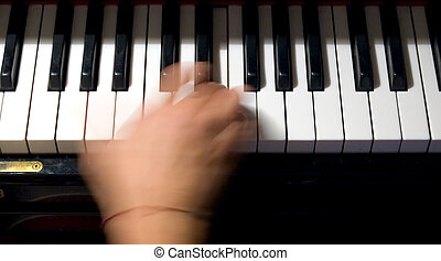 chords and keys - close-up of a hand playing a chord on a...