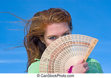 Fanning - Attractive red head using an Asian fan