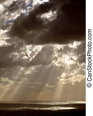 Gods Light - Clouds looming over the horizon with rays...